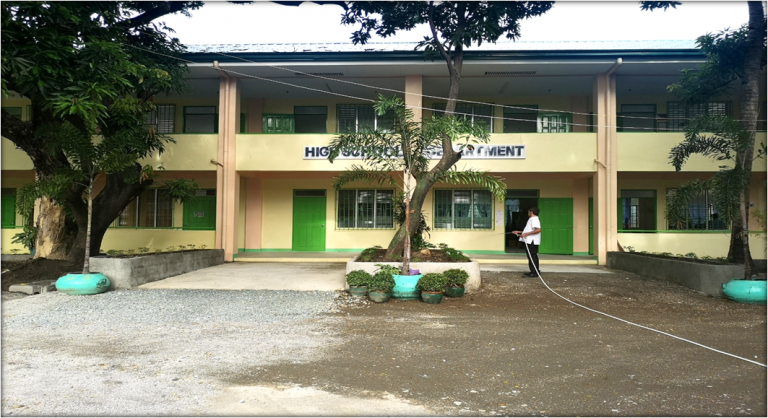 The image shows the constructed Plant Boxes and cemented Path Walks on the new Junior High School Building