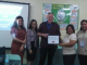 Picture of the Pacific Vision staff, Ms. Joy Kamacho and Mr. Barry Burgees with Mrs. Corazon Salvador and Ms. Larnie Lebuna of PNSB